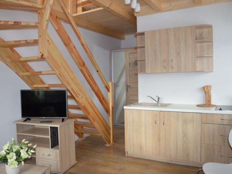 Pokój dzienny w apartamencie B